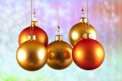 Red and gold baubles on abstract background. Red and gold baubles on abstract colored background Royalty Free Stock Photos