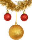 Red and gold baubles. Red and gold bauble Christmas decorations hanging from tinsel isolated against white Royalty Free Stock Photos