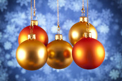 Red and gold baubles on blue background. Red and gold baubles on blue abstract background Stock Image
