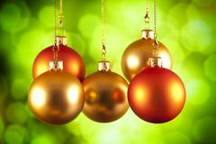 Red and gold baubles on green background. Red and gold baubles on green abstract background Royalty Free Stock Image