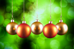 Red and gold baubles on green background. Red and gold baubles on green abstract background Royalty Free Stock Photo