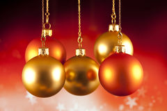 Red and gold baubles on red background. Red and gold baubles on red abstract background Stock Photography