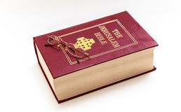 Red and gold Bible and reading glasses Royalty Free Stock Photo