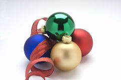 Red,gold,blue,and green ornaments. With ribbon Stock Images