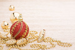 Red and gold christmas ball on illuminated background. Red and gold christmas balls on illuminated background Royalty Free Stock Photo