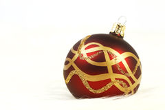 Red and gold christmas ball on white fur background Royalty Free Stock Photos