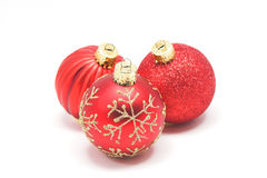 Red and Gold Christmas Balls. Red glass Christmas ornaments with gold accents on white Royalty Free Stock Photos