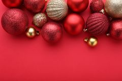 Red and gold christmas balls on a red background royalty free stock photos