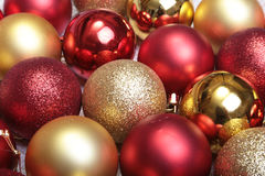 Red and gold christmas balls on a wooden background Stock Photos