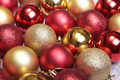 Red and gold christmas balls on a wooden background Royalty Free Stock Photos