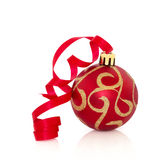 Red and Gold Christmas Bauble. Red and gold sparkling christmas bauble with ribbon, isolated over white background Stock Image