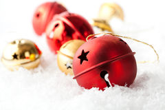 Red and gold Christmas baubles. Resting in snow Royalty Free Stock Photos
