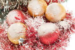 Red and gold christmas baubles. On white Stock Photo