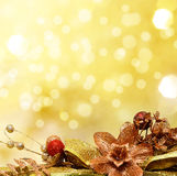 Red and gold Christmas baubles on background. Of defocused golde Stock Photos