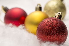 Red and gold Christmas baubles - Stock Image Stock Photos