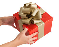Red gold christmas birthday gift box holding hands Stock Photo