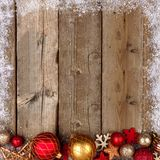 Red and gold Christmas bottom border with snow on wood Stock Images