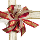 Red and Gold Christmas Bow. Christmas ribbon bow in red and gold, over white background Royalty Free Stock Photo
