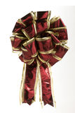 Red and Gold Christmas Bow. Single red and gold christmas bow over white Royalty Free Stock Image