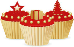 Red and gold Christmas cupcakes Stock Photography