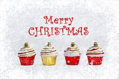 Red and gold Christmas cupcakes on white background stock photography