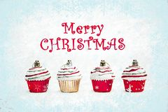 Red and gold Christmas cupcakes on white background stock photo