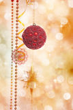 Red and Gold Christmas Decoration on Defocused Lights Background. Red and Gold Christmas Decoration on Defocused Lights Yellow Background Royalty Free Stock Photo