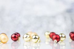 Red And Gold Christmas Decorative Balls. On Blurred Background With Bokeh Royalty Free Stock Images