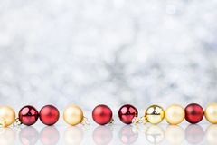 Red And Gold Christmas Decorative Balls. On Blurred Background With Bokeh Stock Image