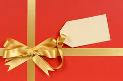 Red and gold Christmas gift ribbon bow Stock Photo