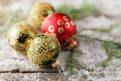 Red and gold christmas ornament pine cones on wooden background Royalty Free Stock Photography