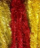 Red and gold Christmas tinsel Royalty Free Stock Photos