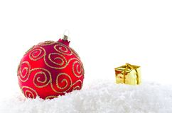 A red and gold christmass decoration on snow Royalty Free Stock Photo