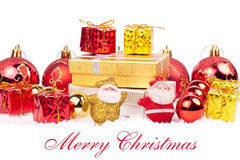 Red and gold combination of xmas ornaments. Many gifts and two santa toys on snow - red and gold combination Stock Images