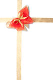 Red and gold decorative bow. With tape, white background royalty free stock images