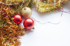 Red and gold decorative Christmas ball and garland on white background Stock Image