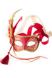 Red and gold feathered carnival mask. Isolated on a white background Royalty Free Stock Image