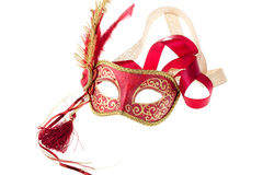 Red and gold feathered carnival mask Stock Images