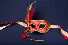 Red and gold feathered mask Stock Photography
