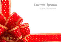Red and gold gift bow and ribbon Stock Image