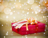 Red and gold Gift Box. On gold background Stock Images