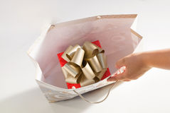 Red gold gift box present inside paper bag isolated Stock Image