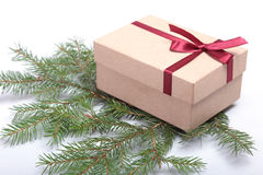 Red and gold gift box on white background. Royalty Free Stock Image