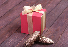 Red and gold gift box on wood background. Stock Images