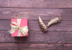 Red and gold gift box on wood background. Stock Photos