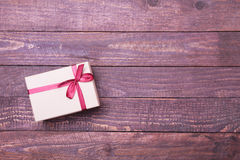 Red and gold gift box on wood background. Stock Image
