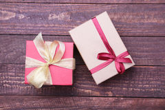 Red and gold gift box on wood background. Royalty Free Stock Photos
