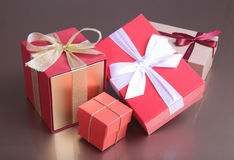 Red and gold gift box on wood background. Royalty Free Stock Photo