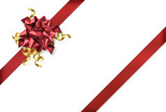 Red and gold gift wrapping. Red and gold gift wrap ribbons on white background royalty free stock photos