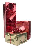 Red and gold gifts. Red metallic gift bags and gold present Stock Images